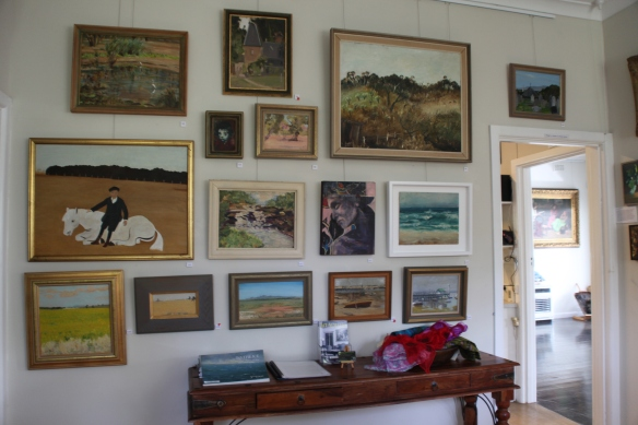 Paintings on this wall include: Sonia Skipper, Alan Martin, Margo Knox, Maurice Hurry, Clem Christesen, Tony Muratore, Joe Hannan, Jenni Mitchell, Mervyn Hannan, Lena Skipper, Leslie Sinclair